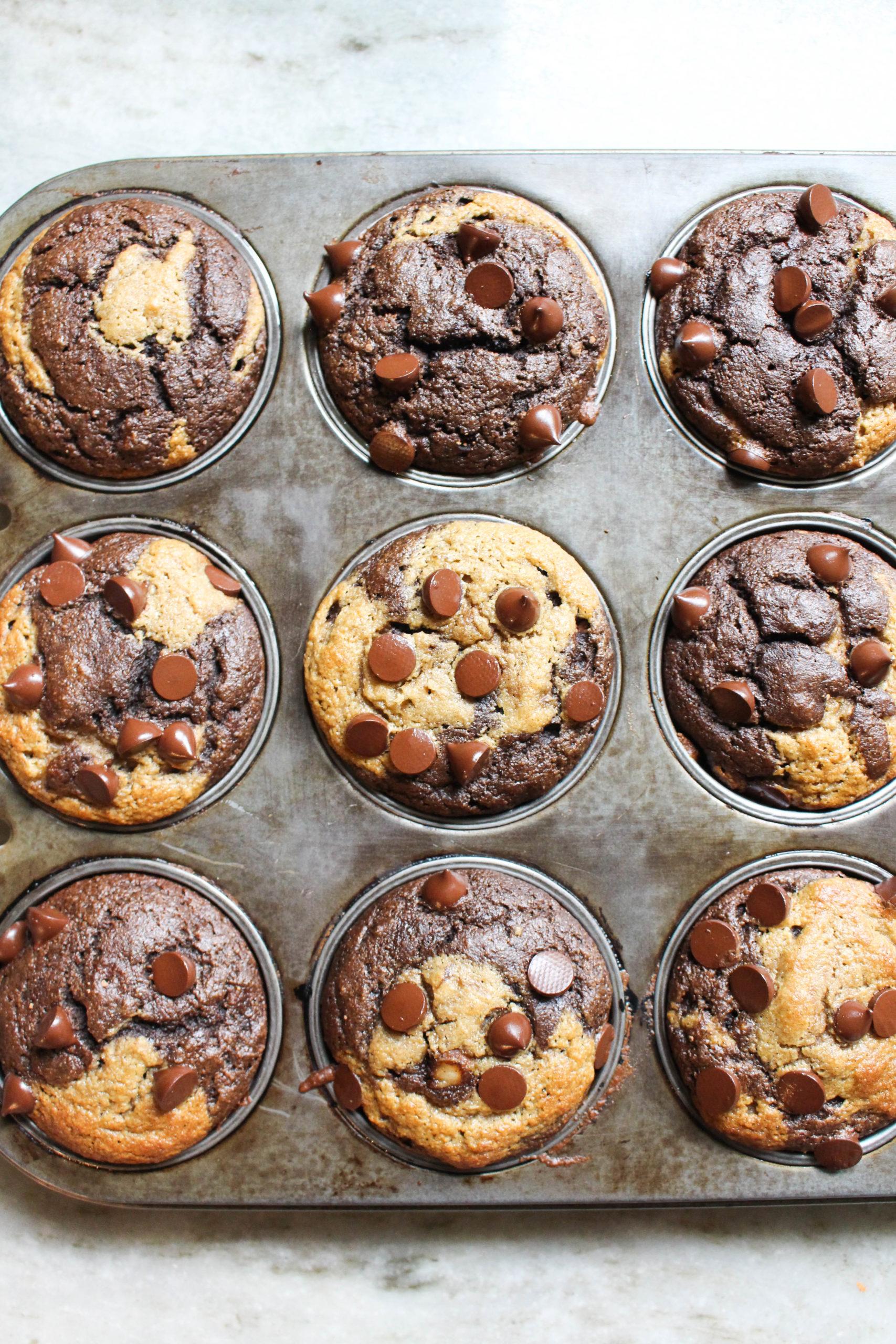 Chocolate twist banana bread muffins in muffin pan.