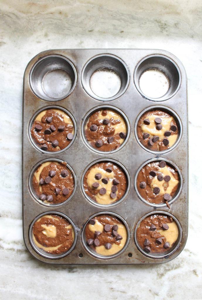 Chocolate twist banana muffins with chocolate chips on top ready to be baked.
