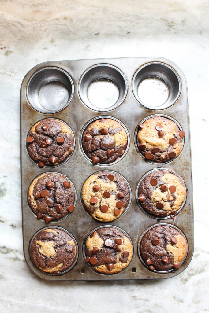 Muffins right out of the oven with melted chocolate chips on top.