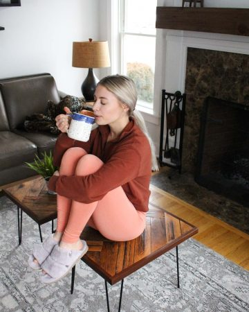 Sipping coffee in active wear.