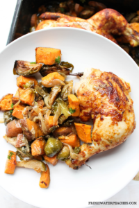 White plate with easy bbq chicken and roasted vegetables.