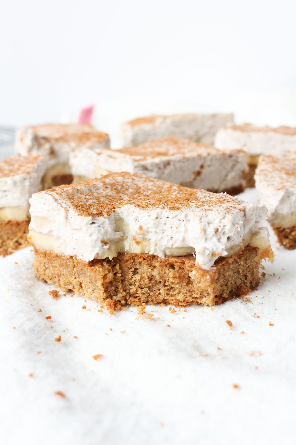 Banana Cream Pie Bar with a large bite taken out and crumbs around the edge.