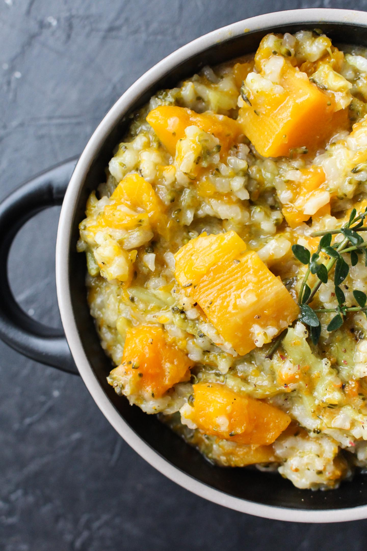 Close up shot of risotto with chunks of butternut squash.