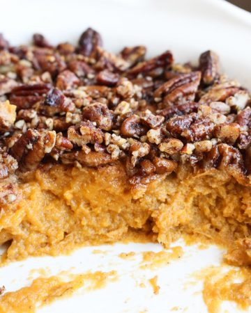 Side angle of the sweet potato casserole so you can see the two layers. Fluffy mashed potato on the bottom and crispy pecans on top!