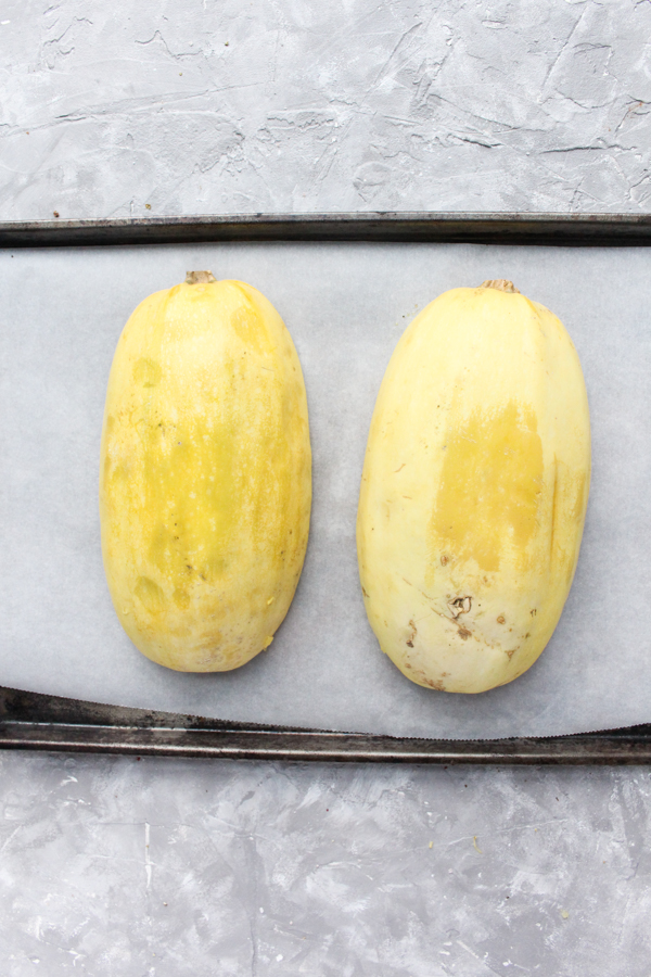 how to cook spaghetti squash - step 5 place face down on baking sheet.