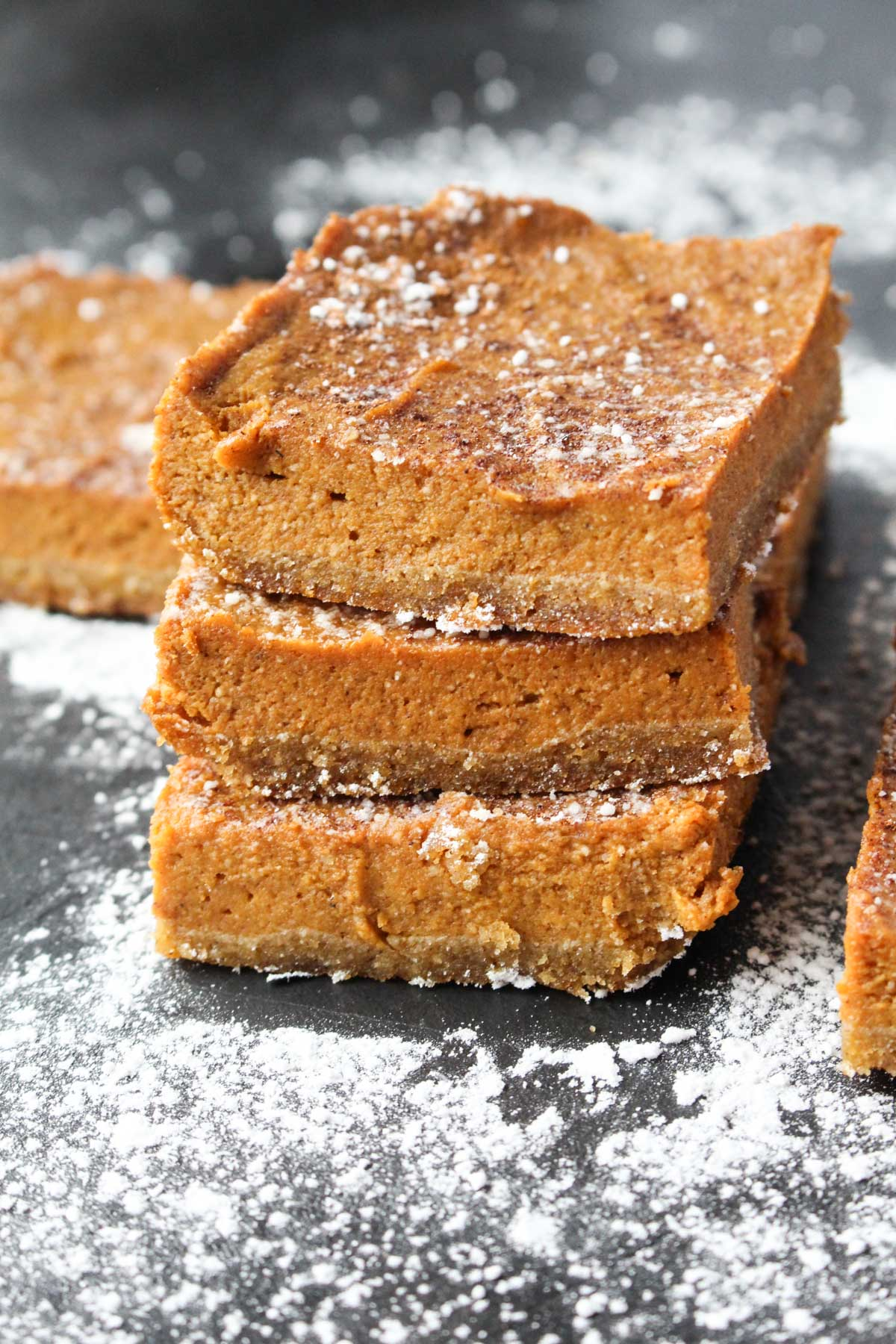 Three pumpkin bars stacked on top of each other.