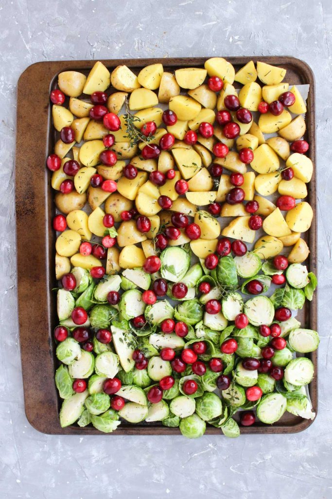 Fall vegetables on the sheet pan before being roasted.