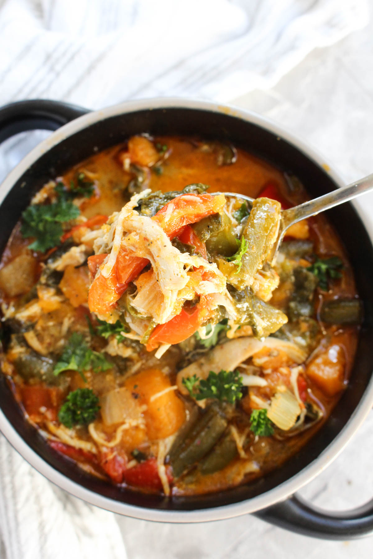 Large spoonful of Thai Red Curry Chicken Soup.