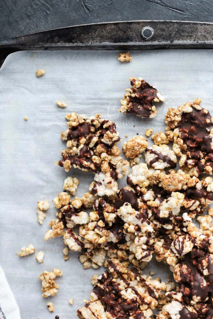Close up overhead shot of Crunchy Snack Bark on parchment paper.