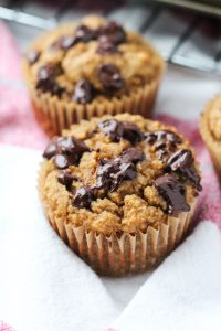 Sweet potato muffin with melted chocolate chips on top.