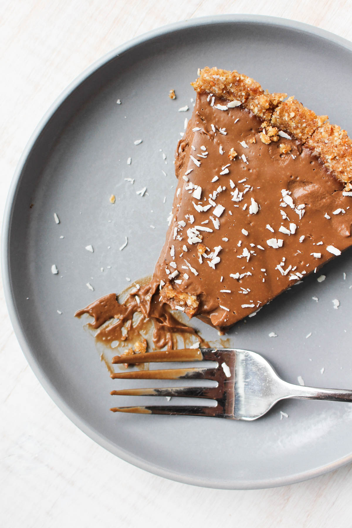 Slice of pie with a fork on the side.