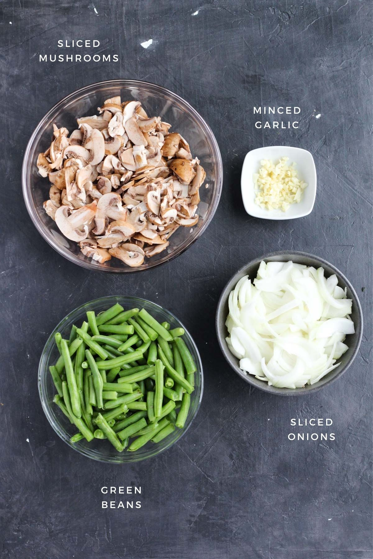 Vegetables prepared and measured out into separate bowls.