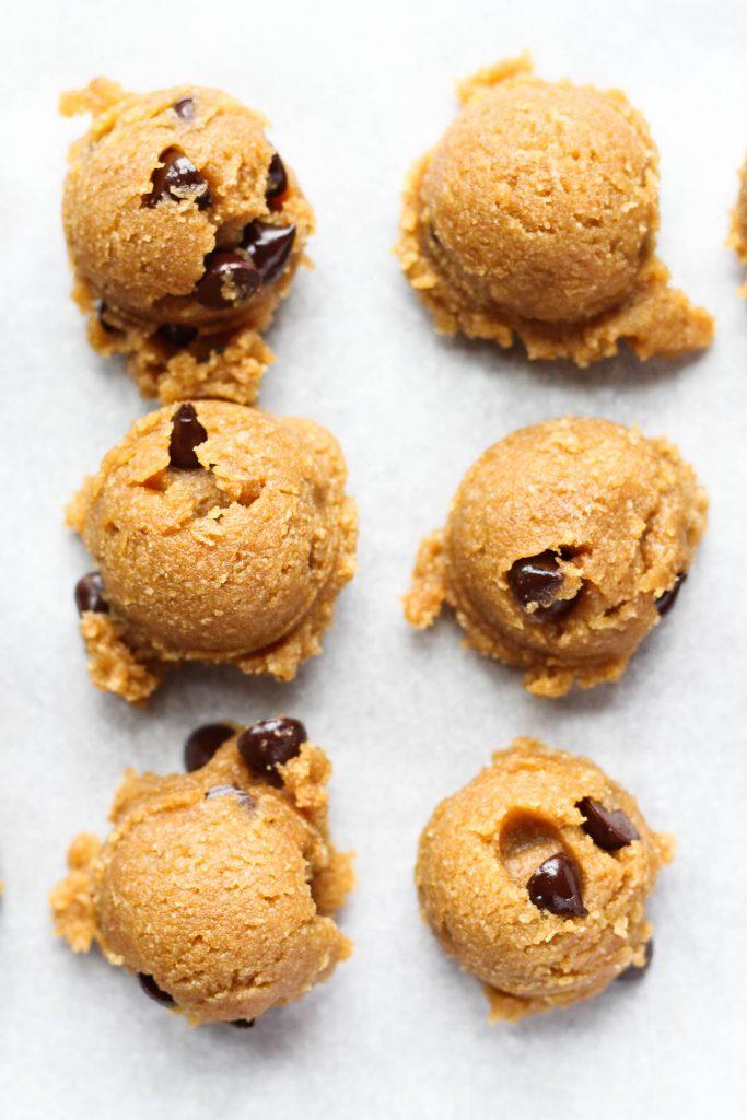 Dough balls on the baking sheet.