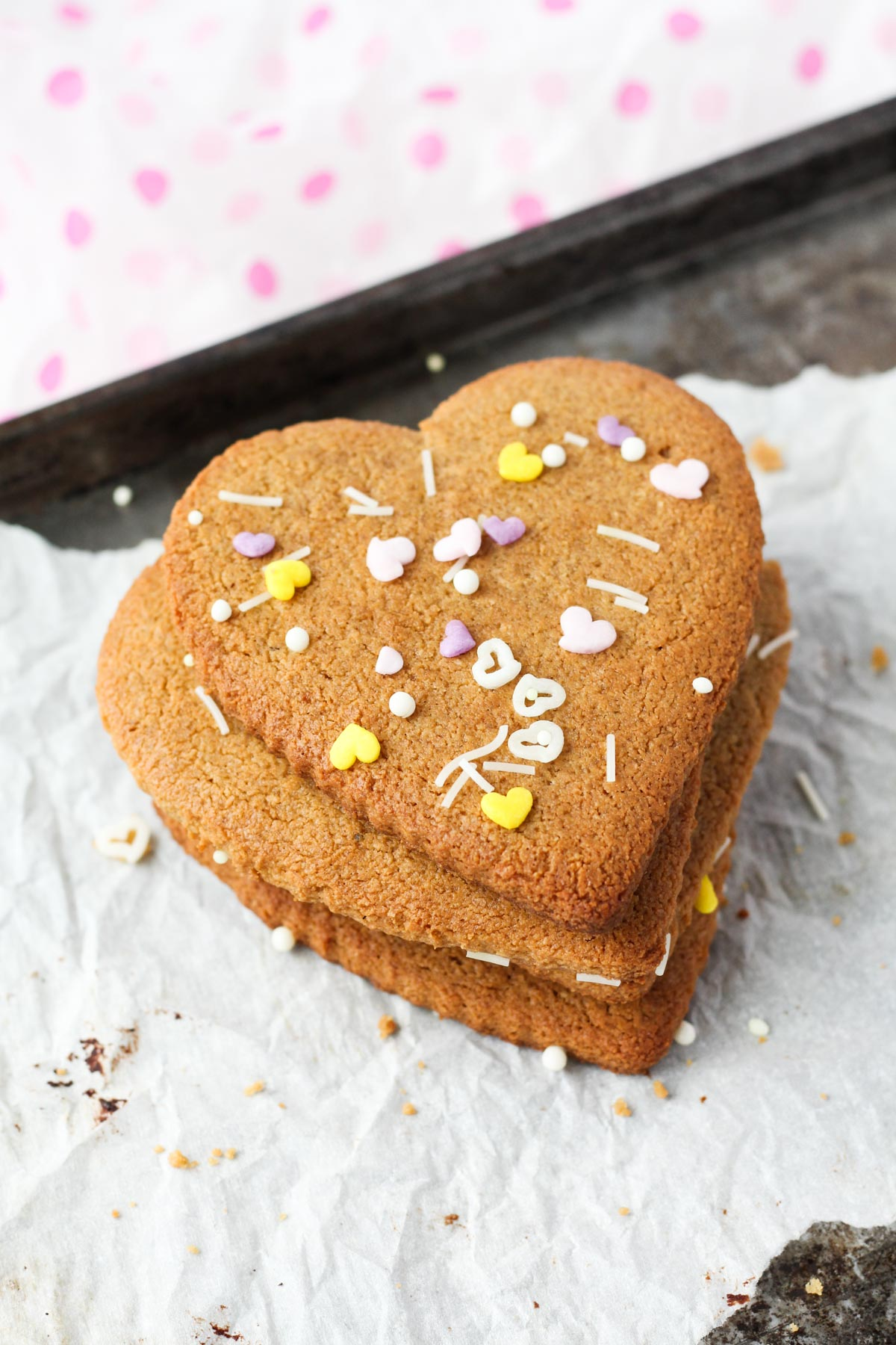 Heart shaped sugar cookies stacked on top of each other.