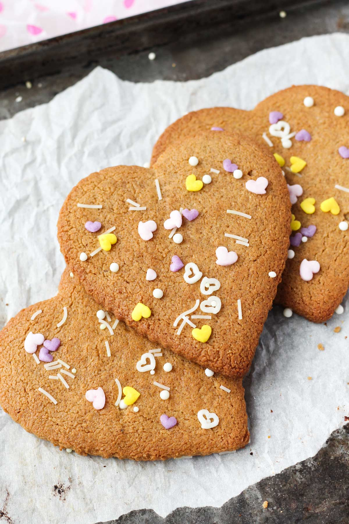 Sugar cookies with colorful sprinkles on top.