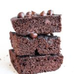 Fudgy paleo brownies stacked on top of each other.