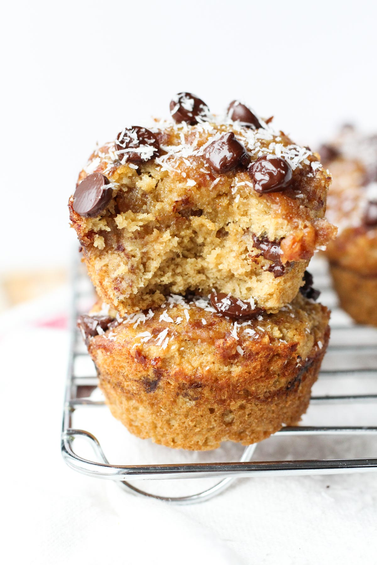 Gluten-Free samoa muffins stacked on top of each other.