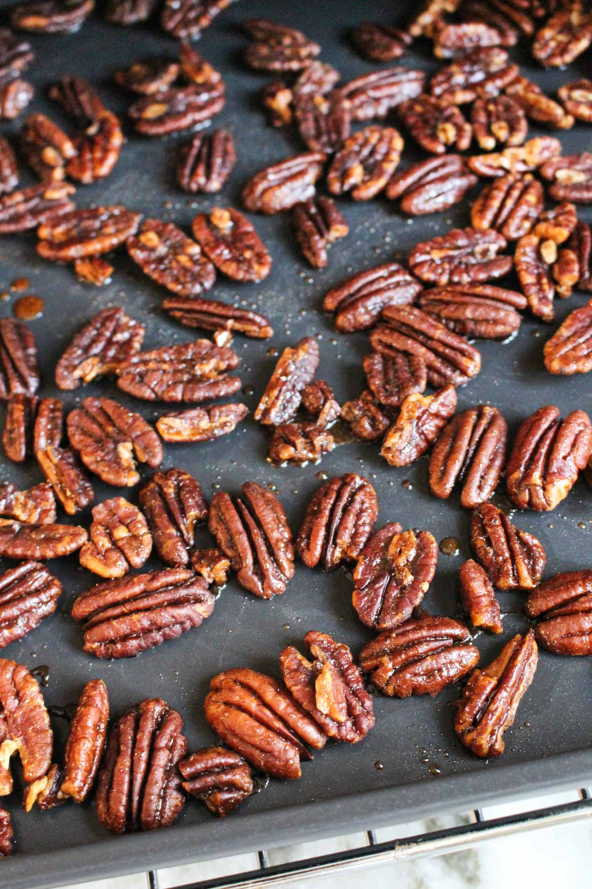 Baking sheet with candied pecans.