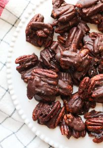 Plate of chocolate pecan turtles.