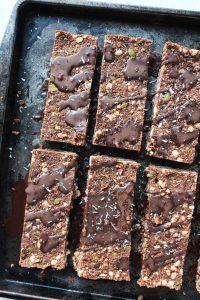 Overhead shot of chocolate energy bars on a baking sheet.