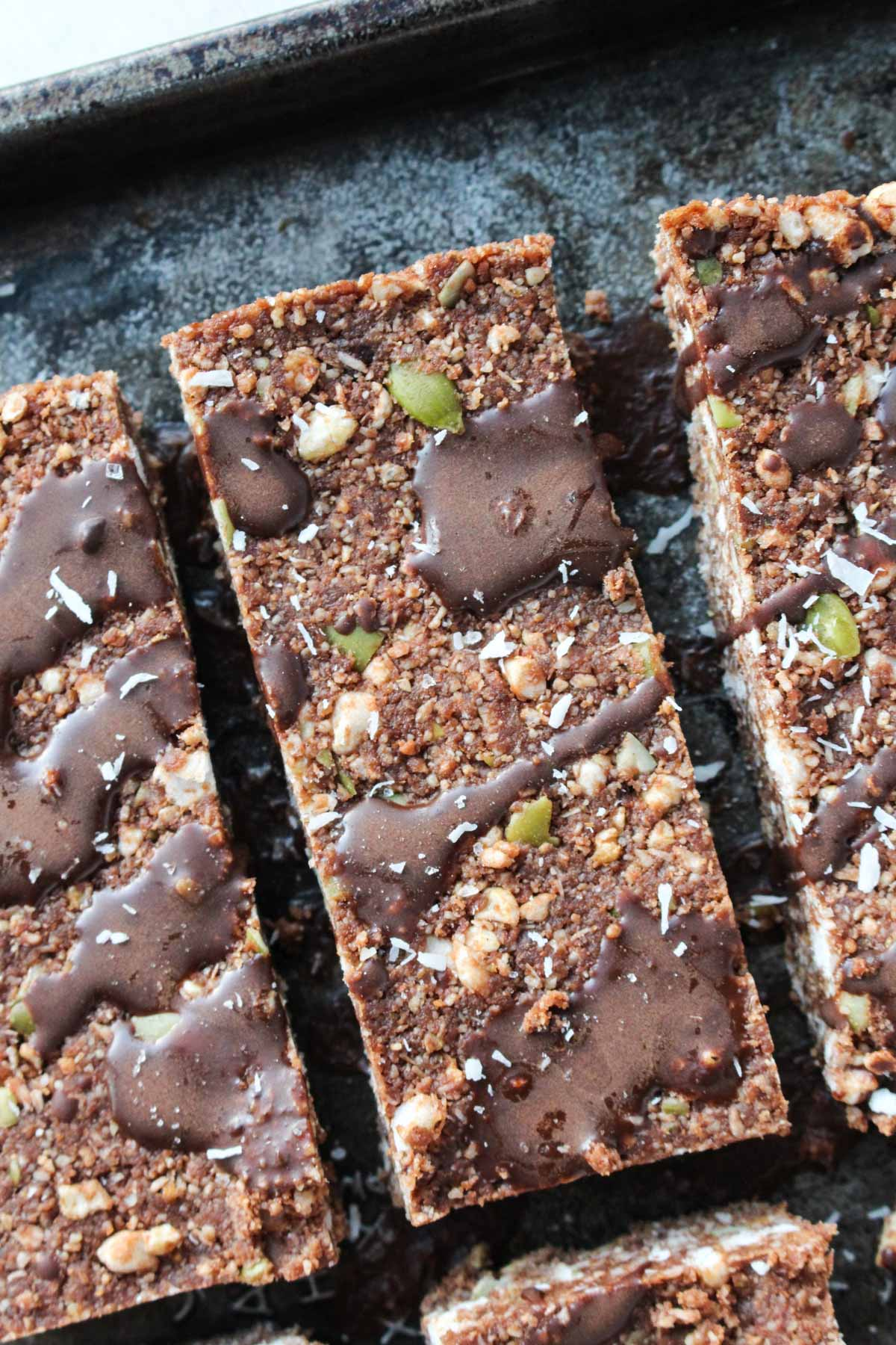 Close up shot of energy bars with chocolate drizzle on top.