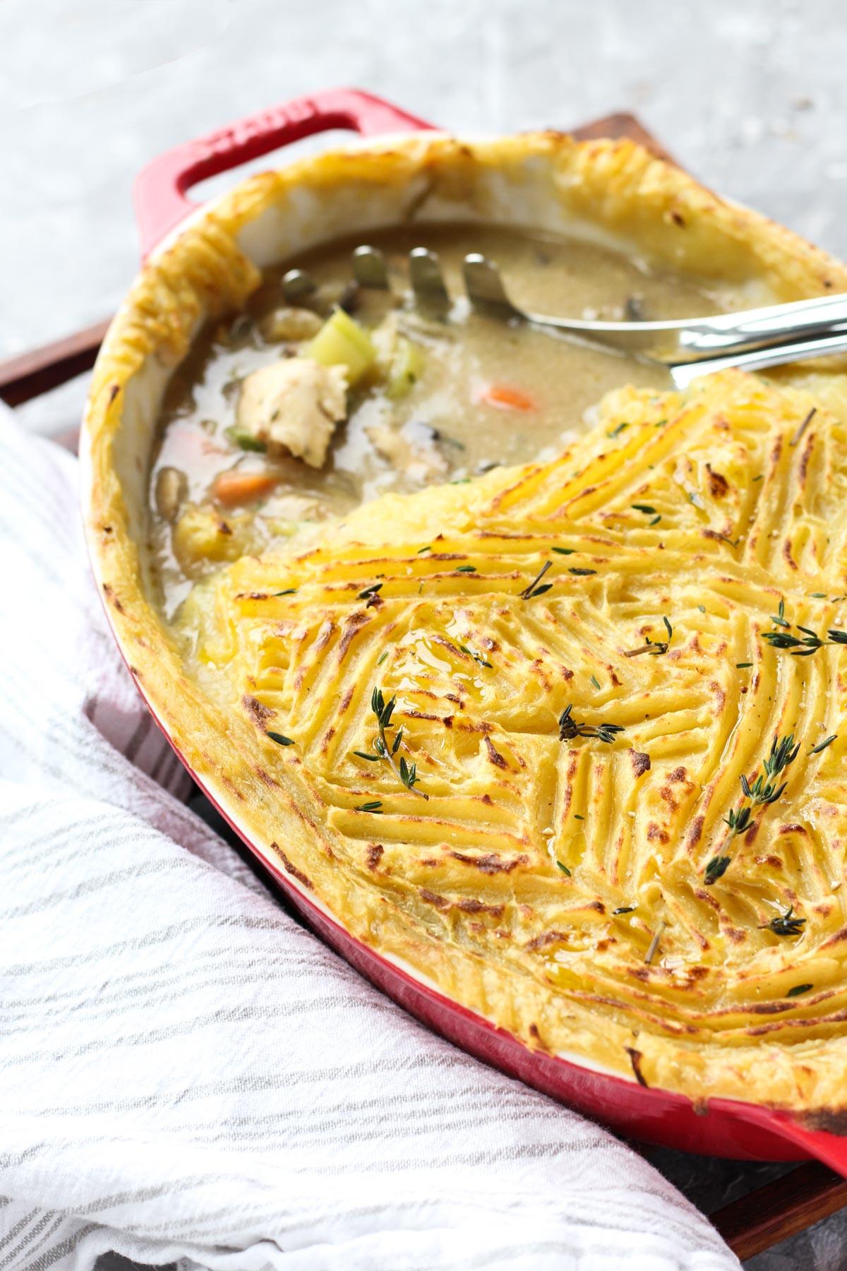 Scoop leaning on casserole dish.