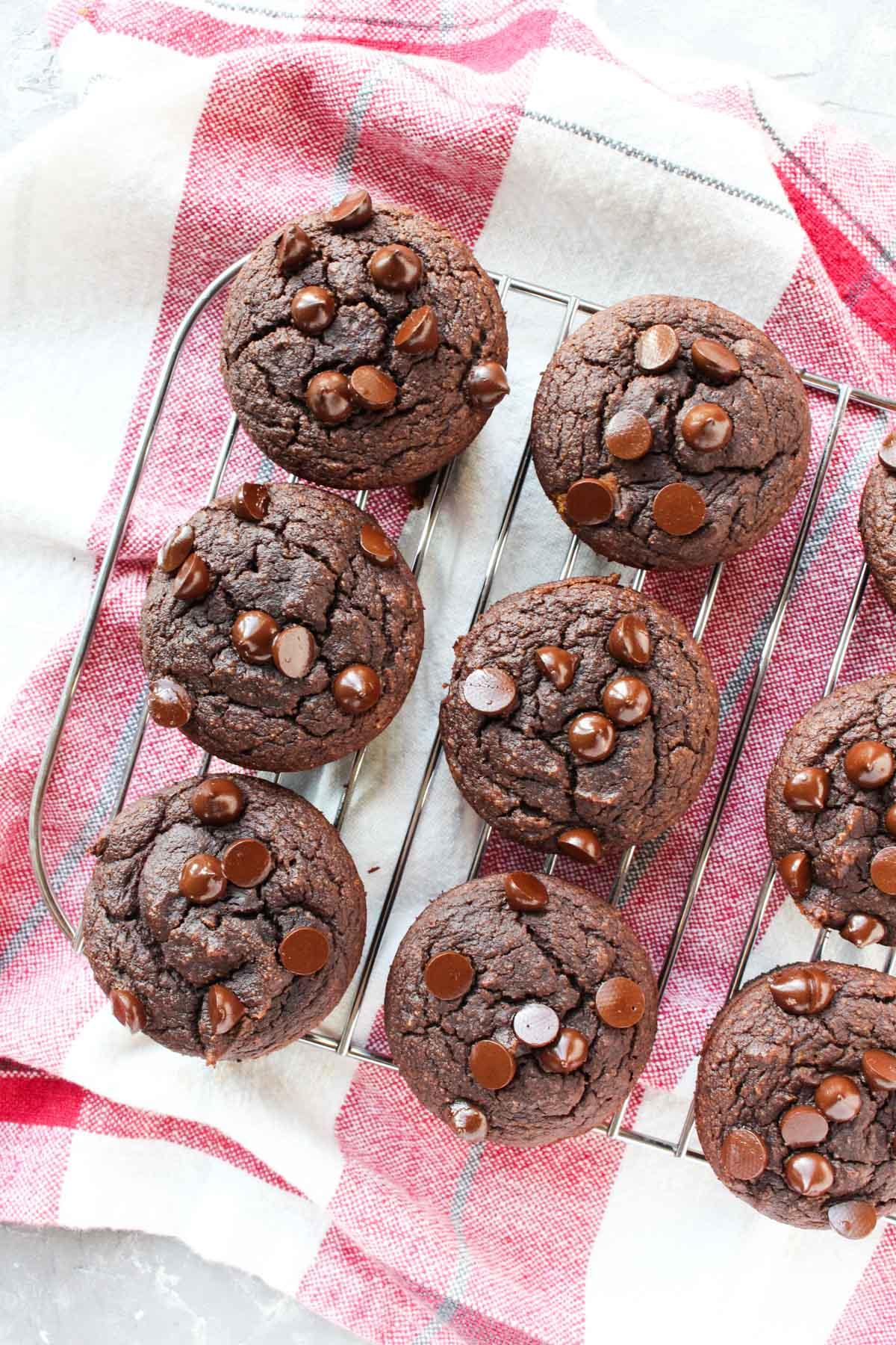 chocolate banana muffins cooling on metal rack.