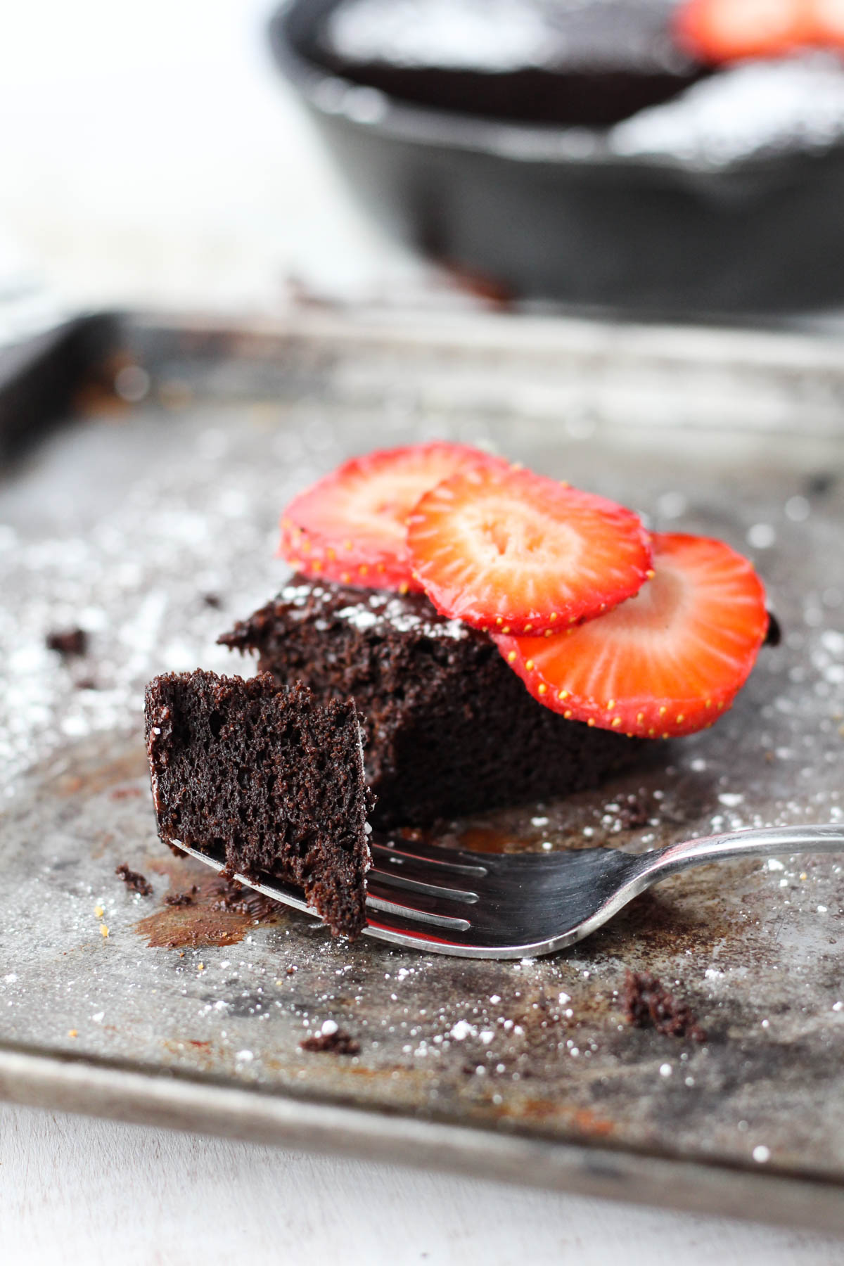 Fork with a bite of chocolate cake.