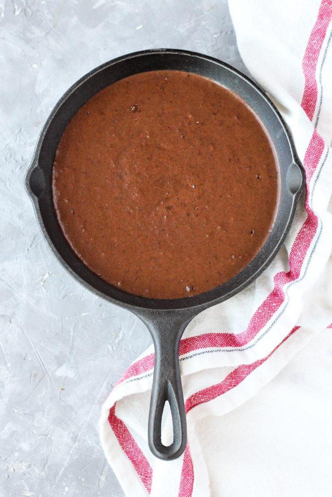 Cake batter in the skillet before baking.