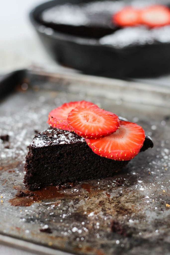 Cake slice with strawberries on top.