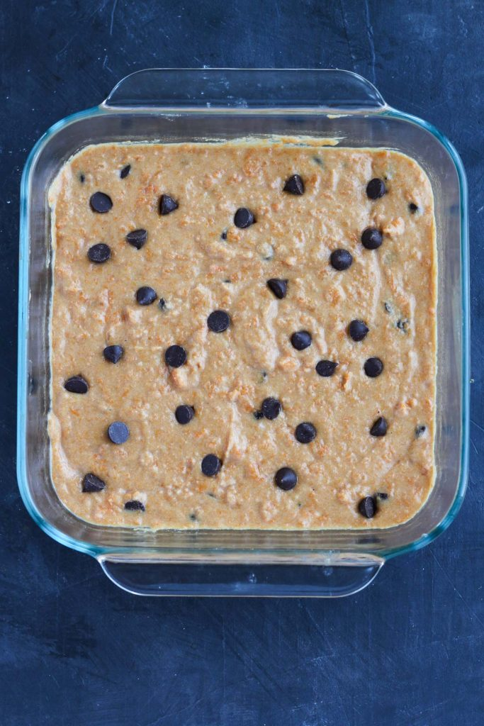 Cookie bars in baking dish before going into the oven.