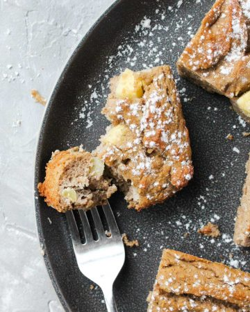 Overhead shot of apple cake on a plate.