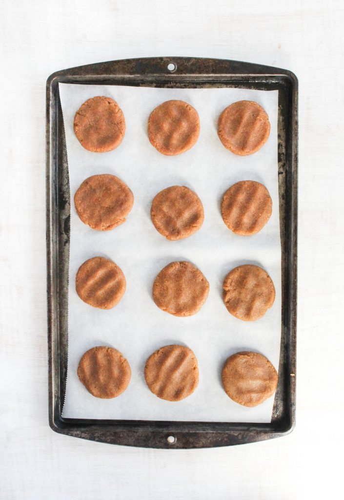 Cookies flattened out on baking sheet.