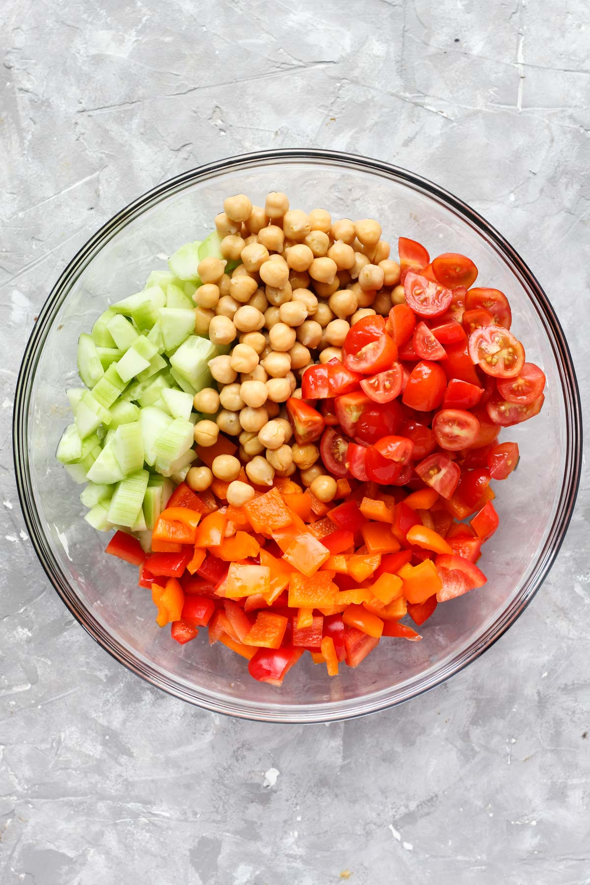 Vegetables and beans in mixing bowl.