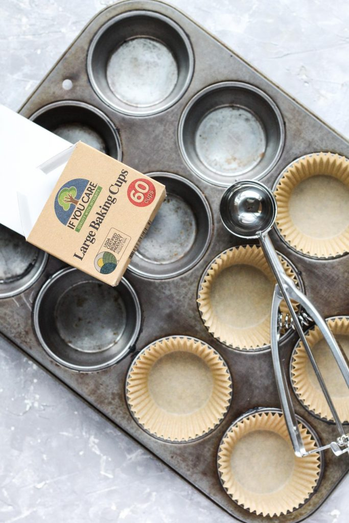 Overhead shot of muffin pan with parchment paper liners.