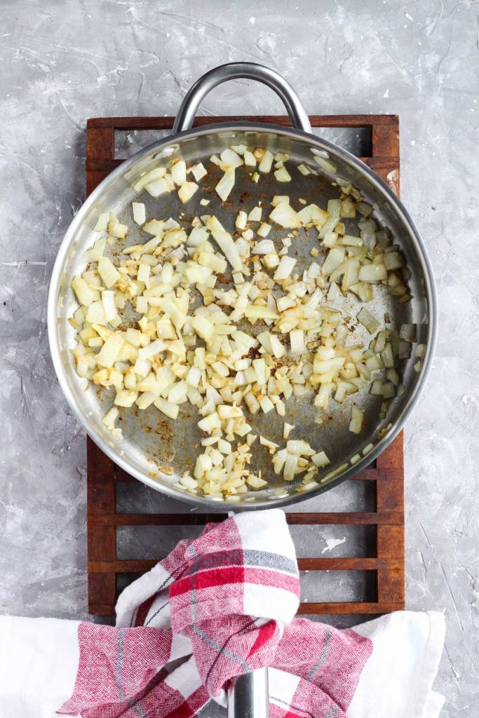 Onions and garlic in pan.