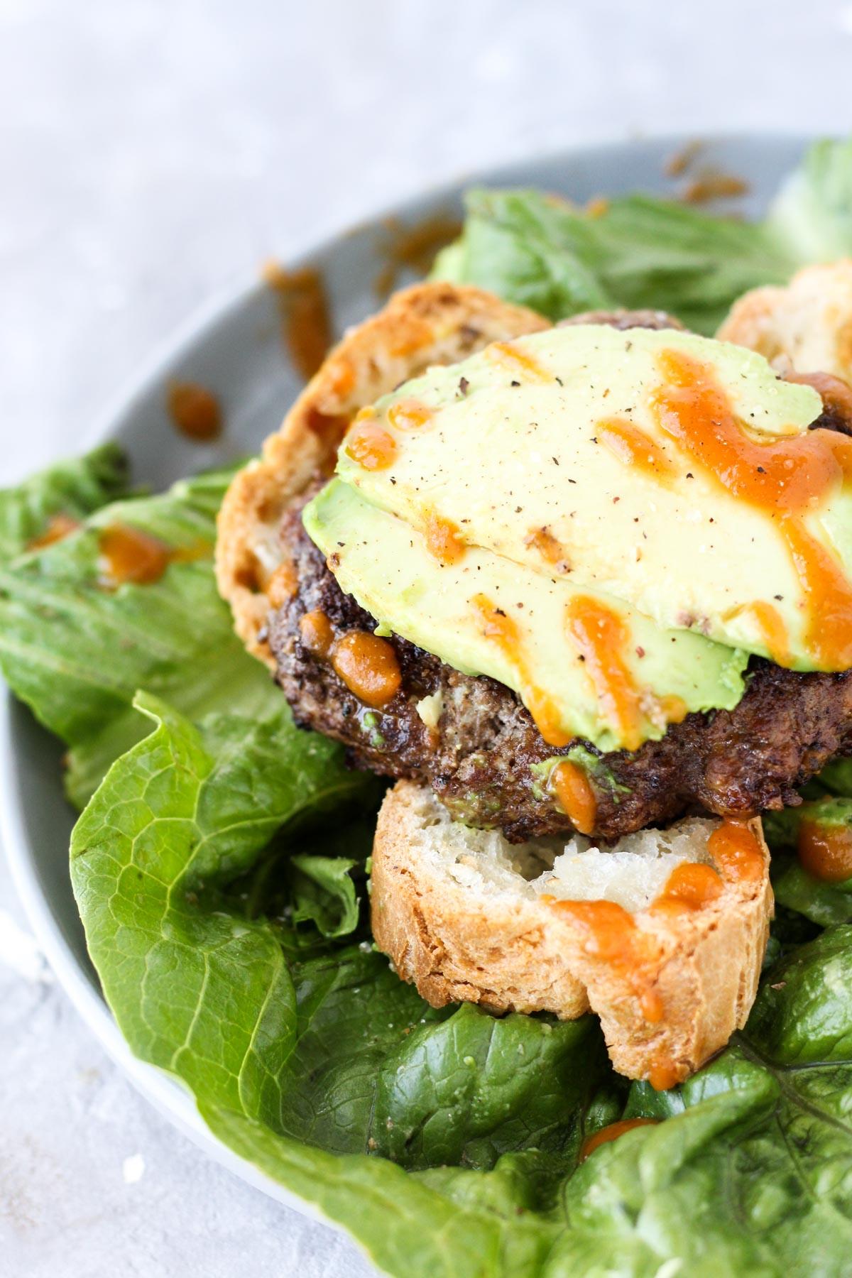 Burger on gluten-free bread with avocado.