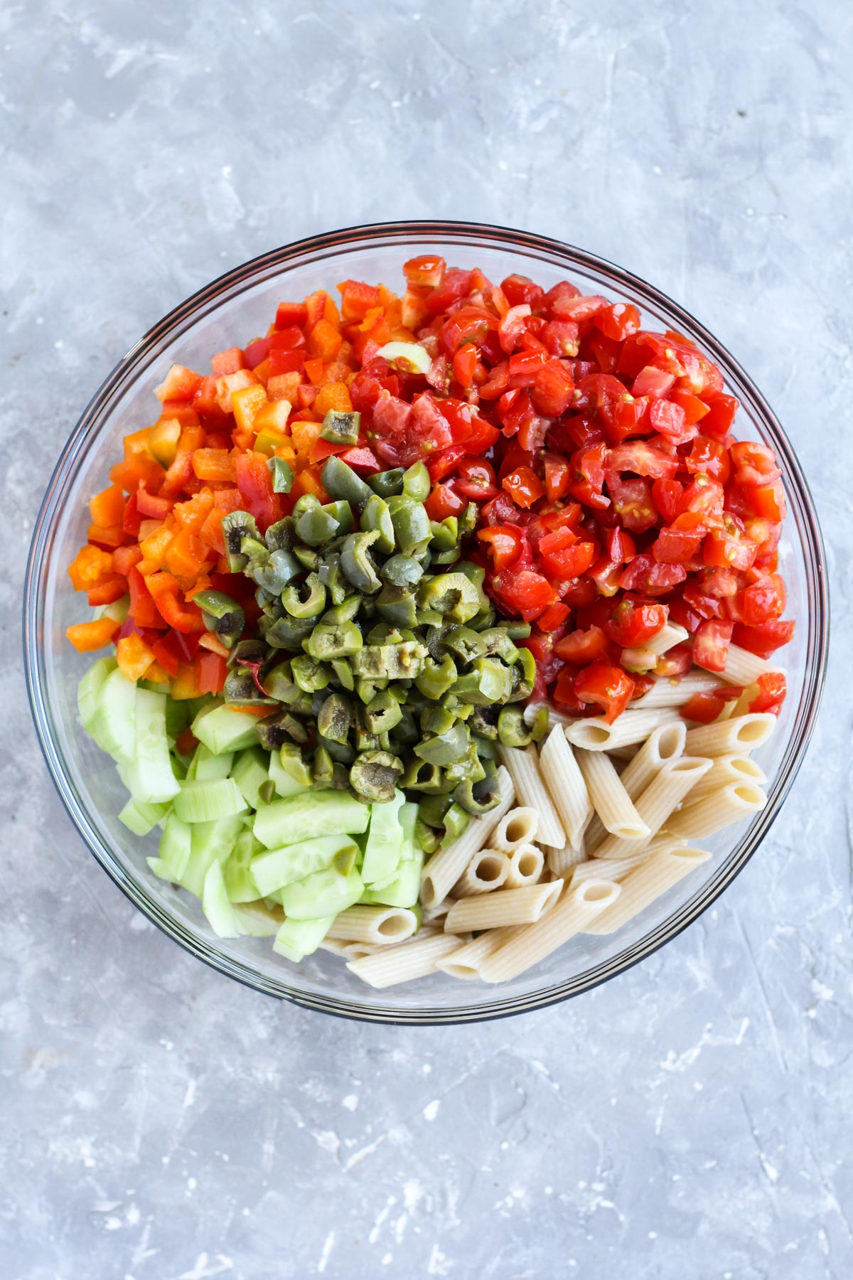 Mixing bowl filled with vegetables and pasta.