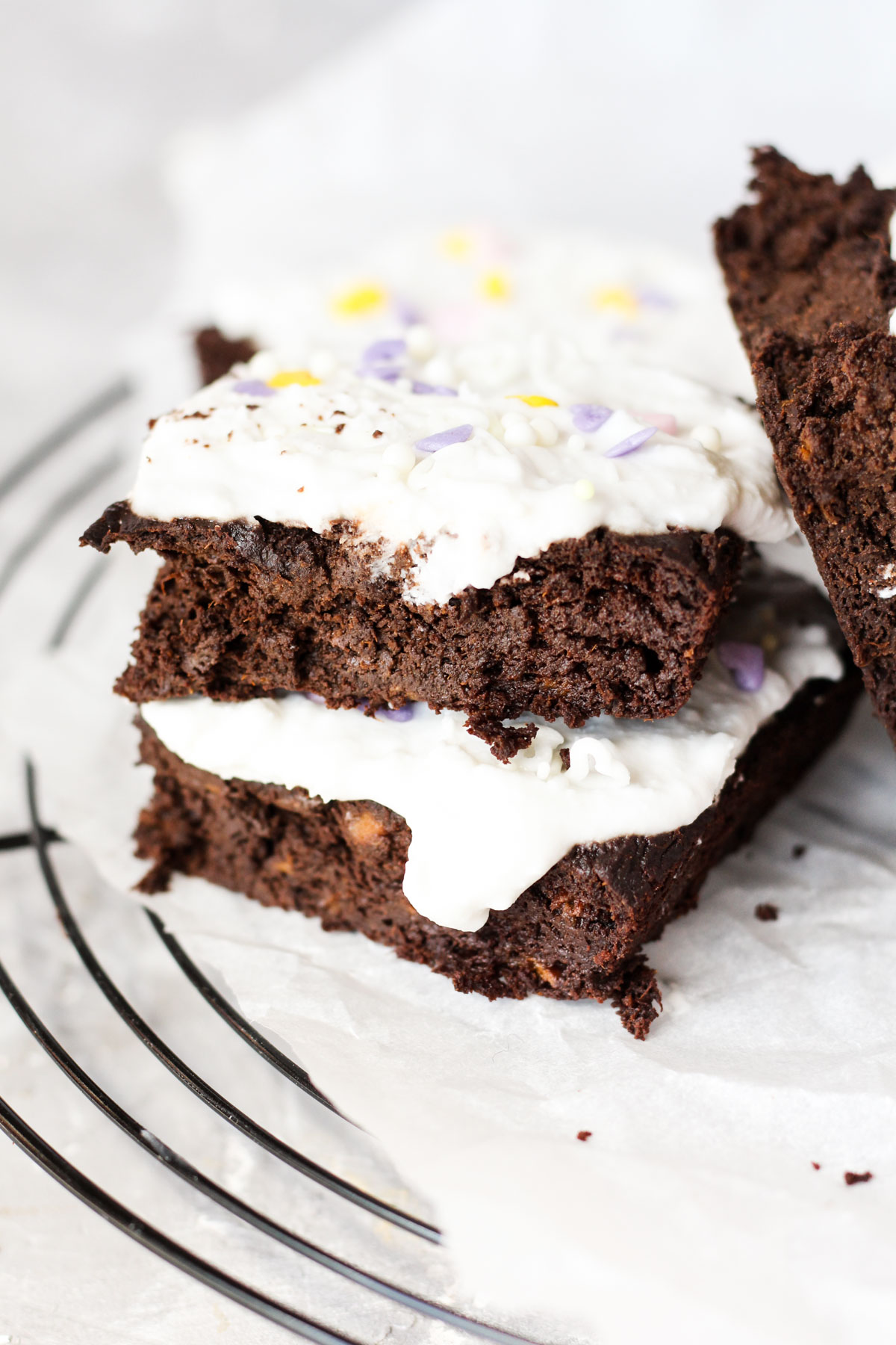 Sweet potato brownies stacked on top of each other.