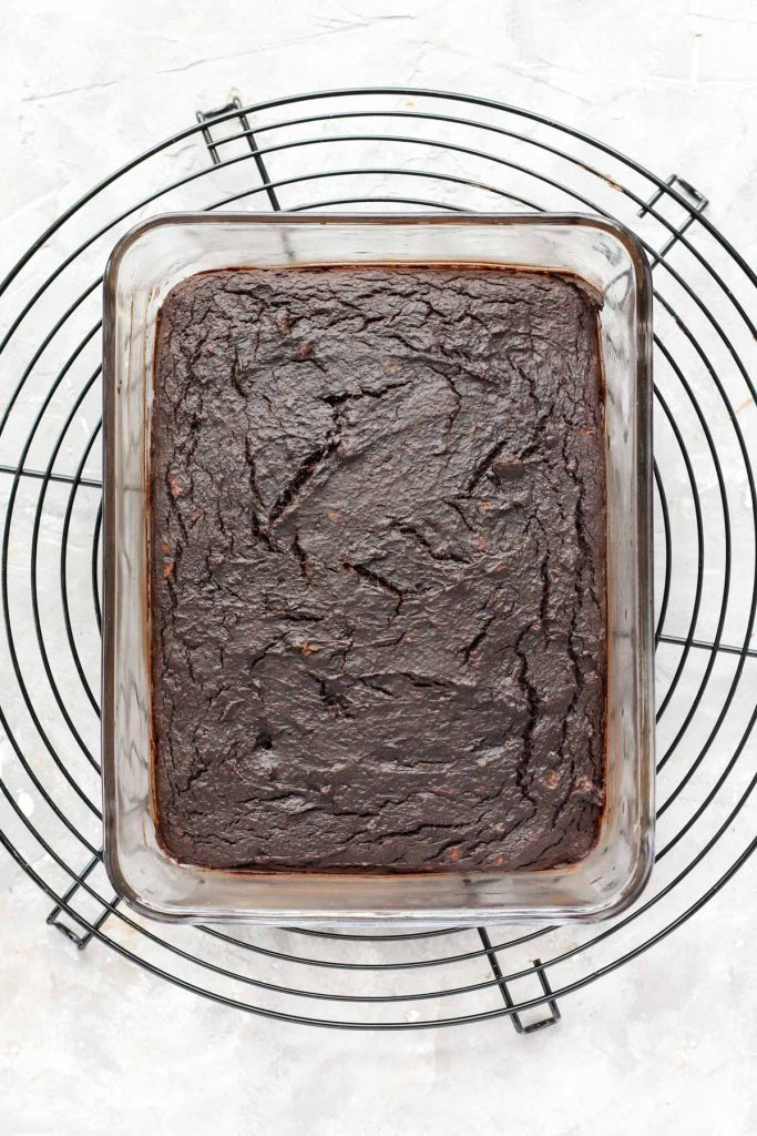 Brownies in glass dish after being baked.