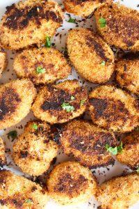 Plate full of crispy sweet potato tots.