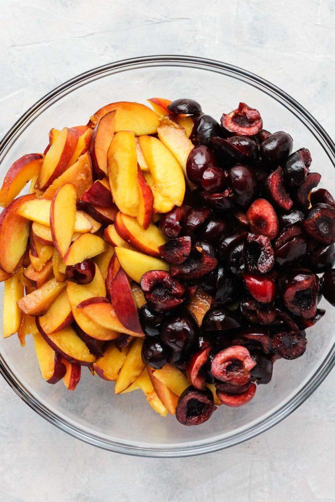Fruit chopped in glass bowl.