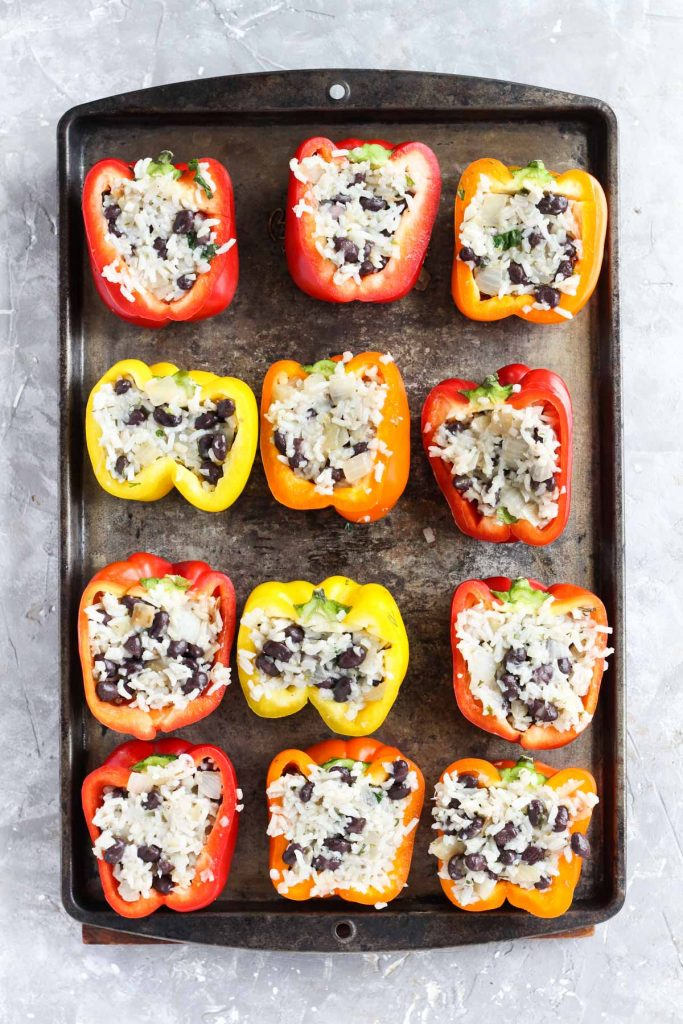 Stuffed bell peppers before being grilled.