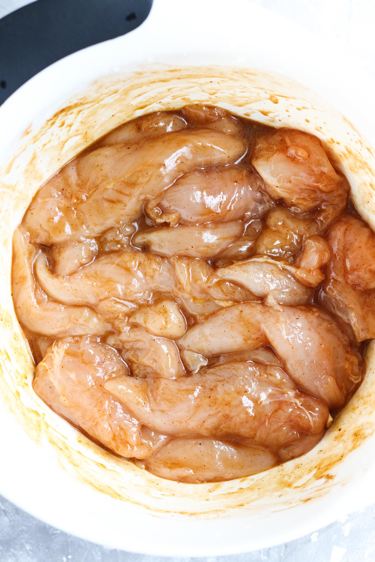 Chipotle chicken marinating in a bowl.