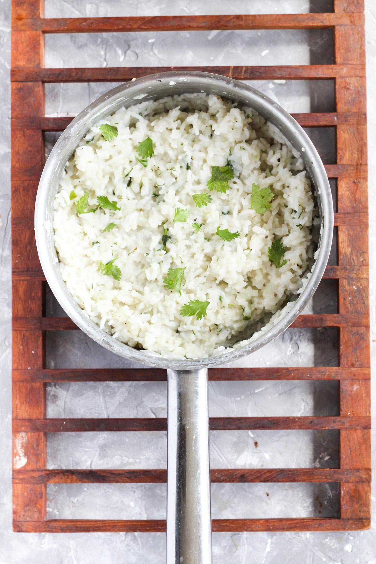 Pot with cooked cilantro rice.