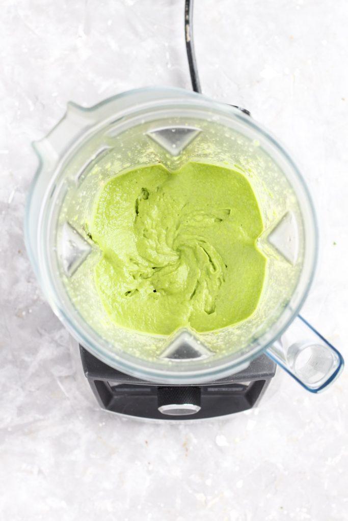 Pesto ingredients blended together.