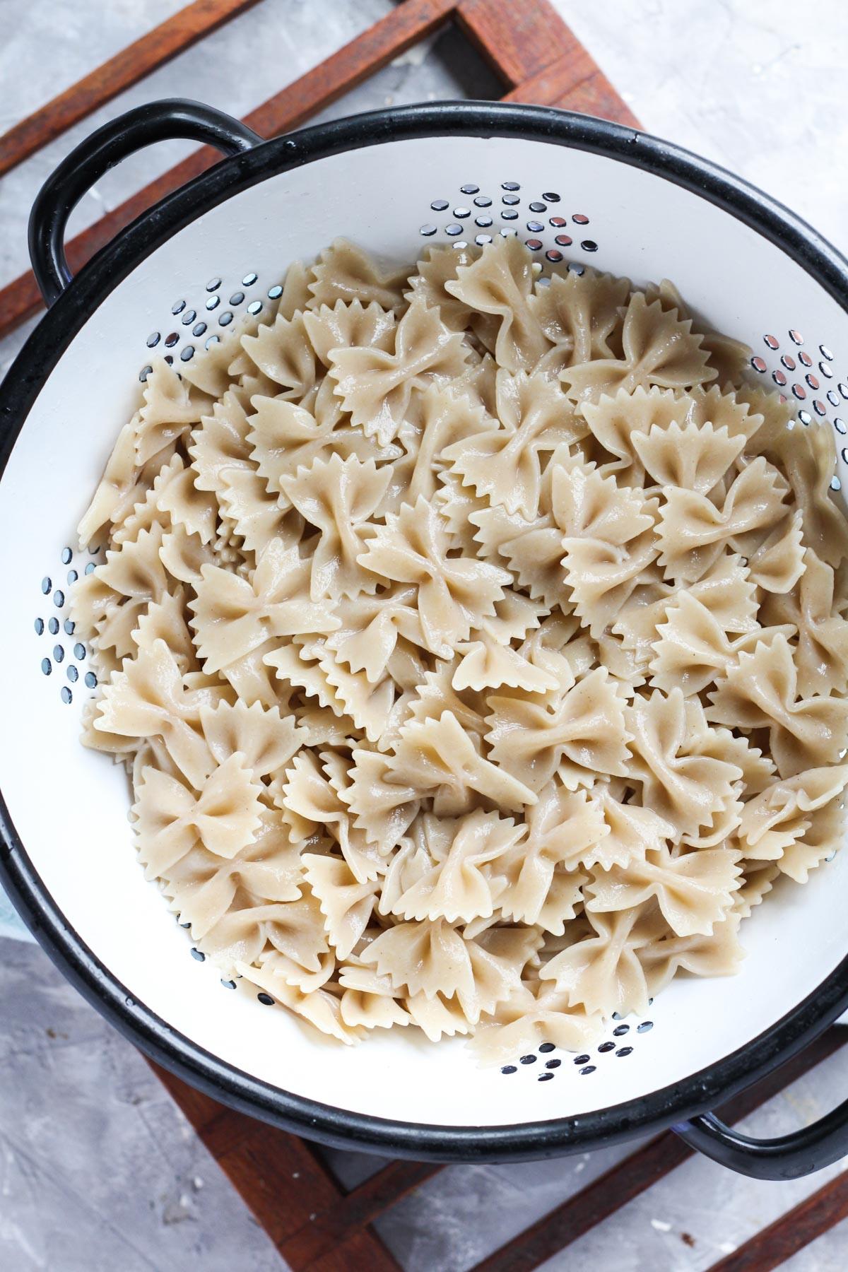 Boiled pasta in strainer.