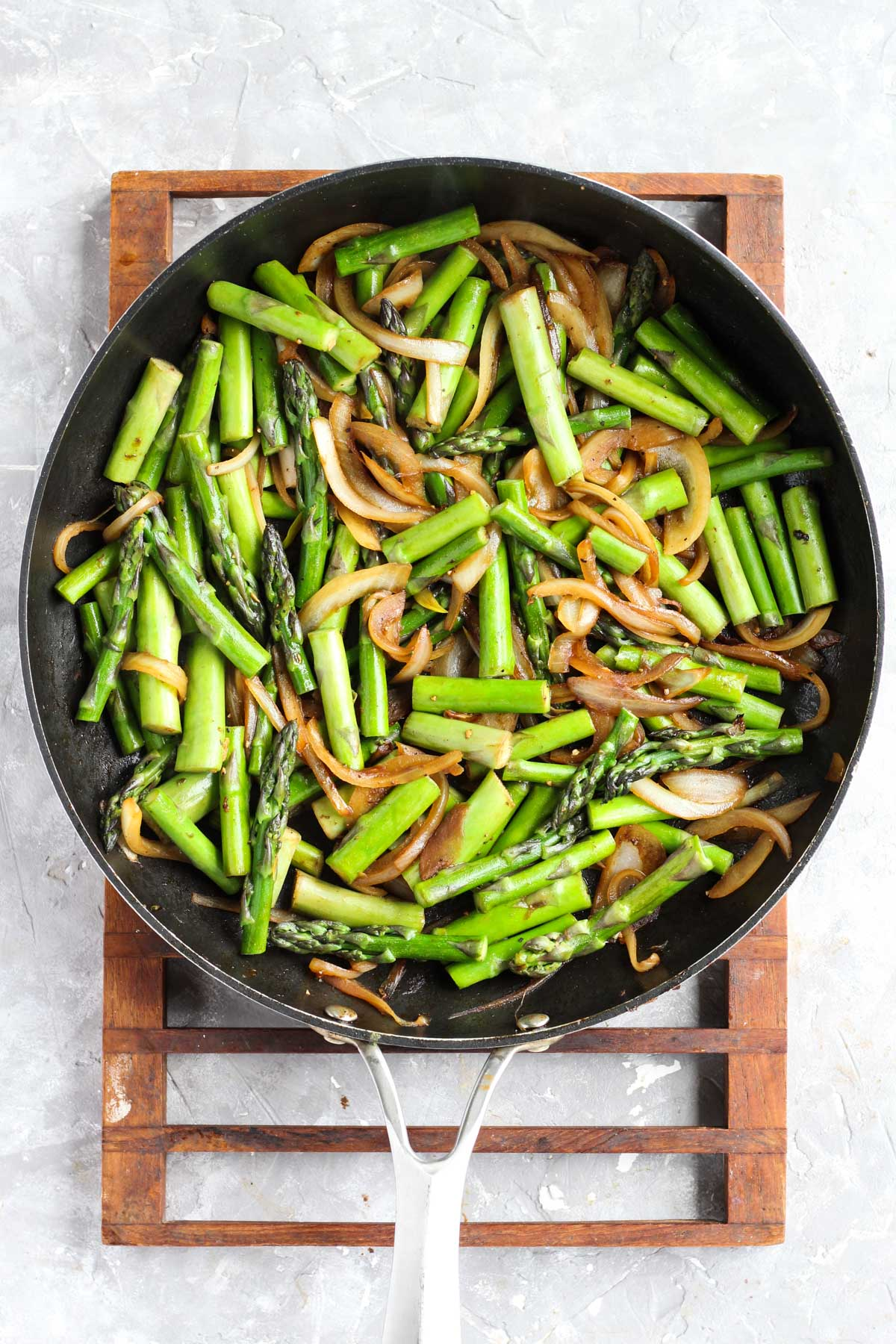 Cooked vegetables in frying pan.