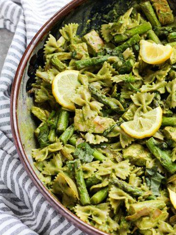 Big serving bowl of pesto pasta.