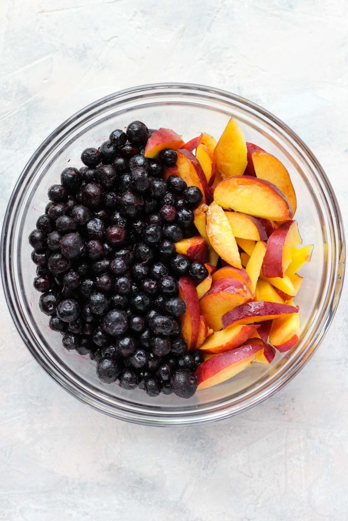 Peaches and blueberries in a bowl.